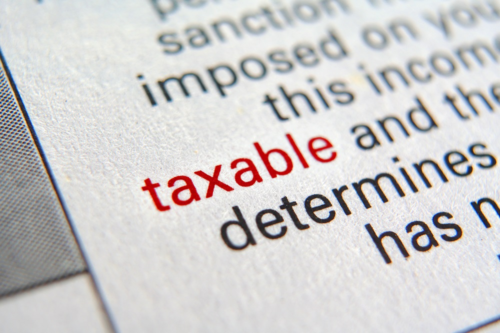 Representing the question, Are personal injury settlements taxable in Hawaii, al coseup on a dictionary definition of the word taxable. The word taxable is in red, while other words and word fragments are in black.