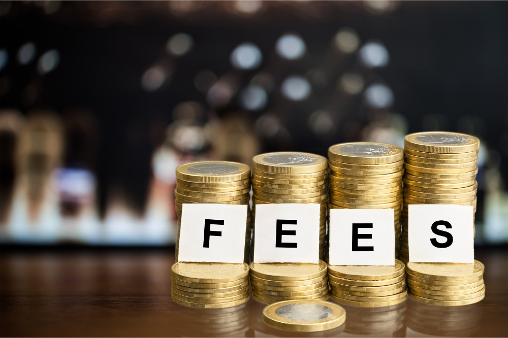 Four stacks of gold coins in a row, each increasing in height from left to right. The word FEES is spelled out by one white square of paper with a corresponding black letter, positing the question, How Much Do Personal Injury Lawyers Charge in Kona and Kamuela?